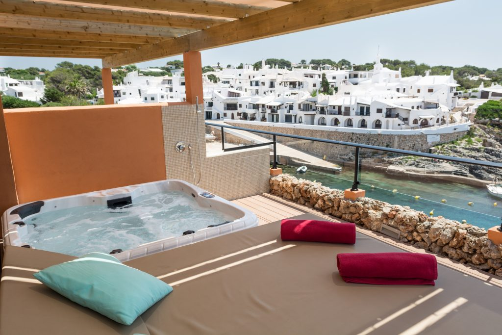 private terrace with canopy beds in Menorca Binibeca