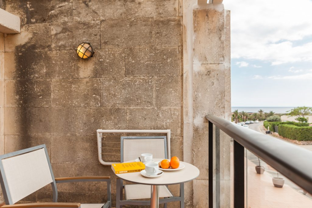 Balcony with two chairs in Menorca Binibeca